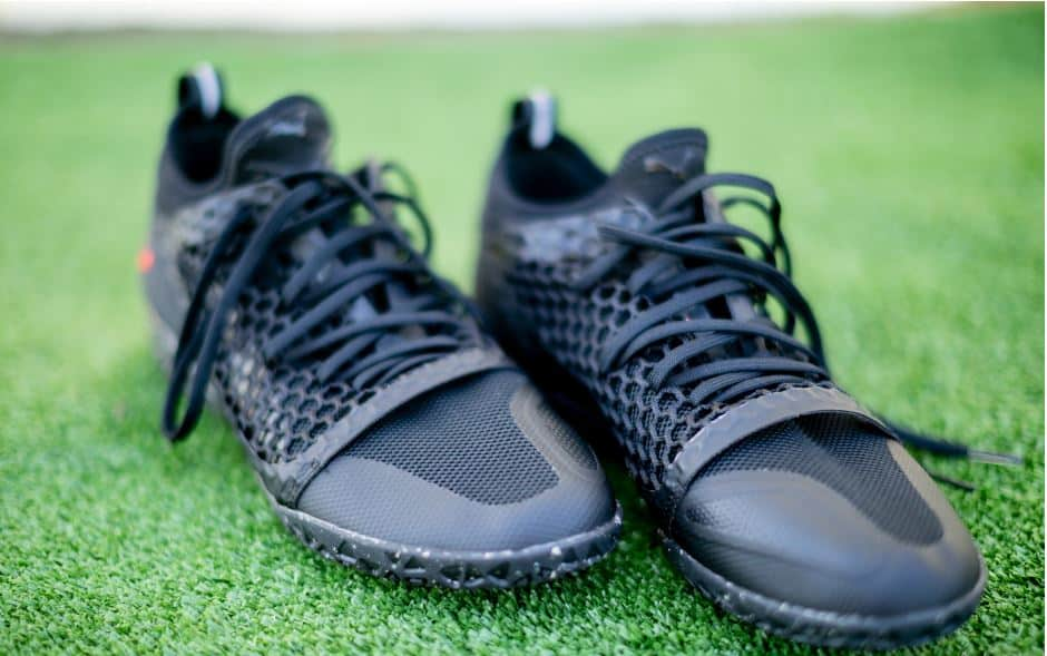 Close up of some black indoor soccer shoes