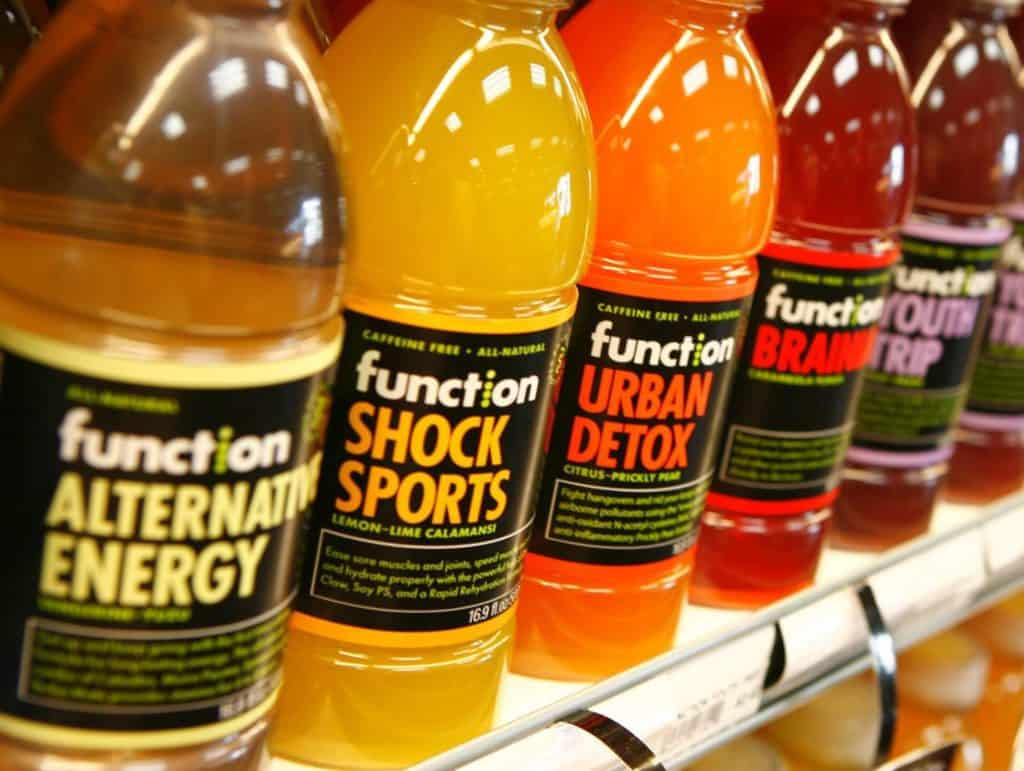A row of multi colored healty sports drinks and detox juices
