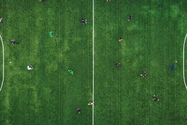 Top view of an green field with players in position
