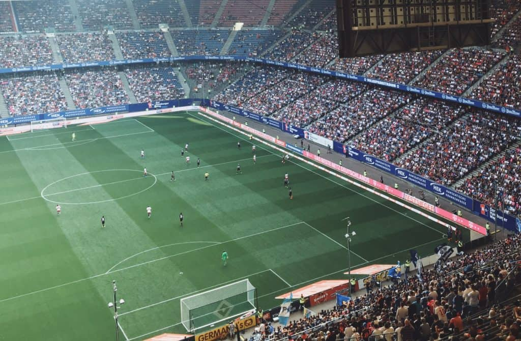 Soccer game in a fully packed stadium