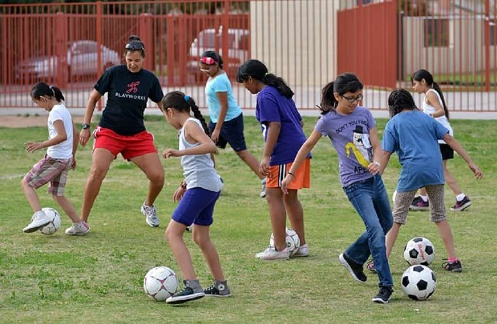 A group of soccer players doing drills 1v1 style