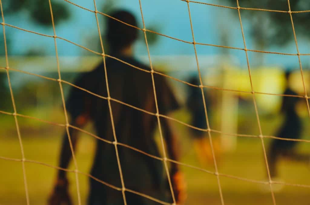 Soccer goalie standing in front of a net