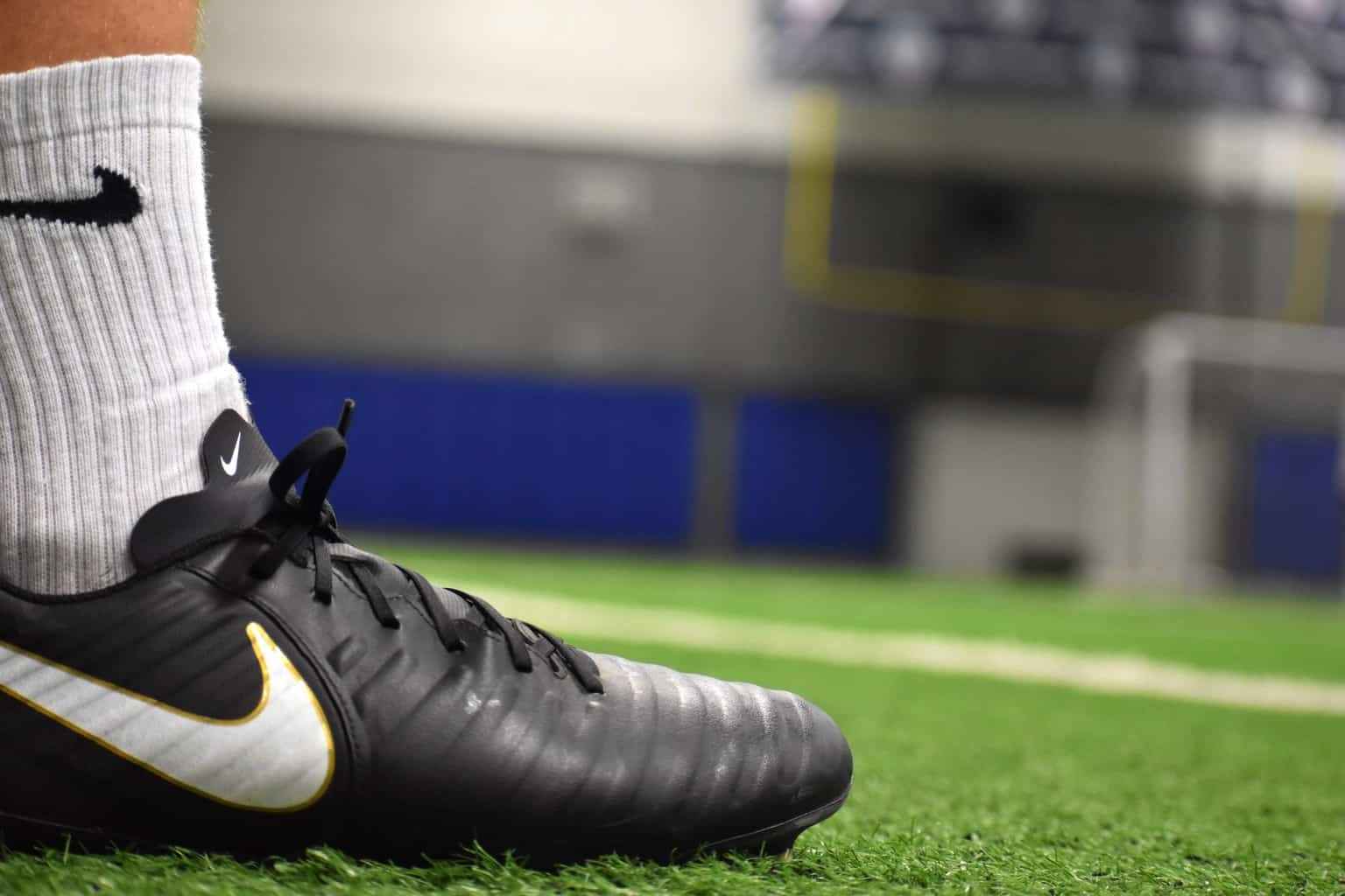 Close up side view of a black Nike Soccer Shpe