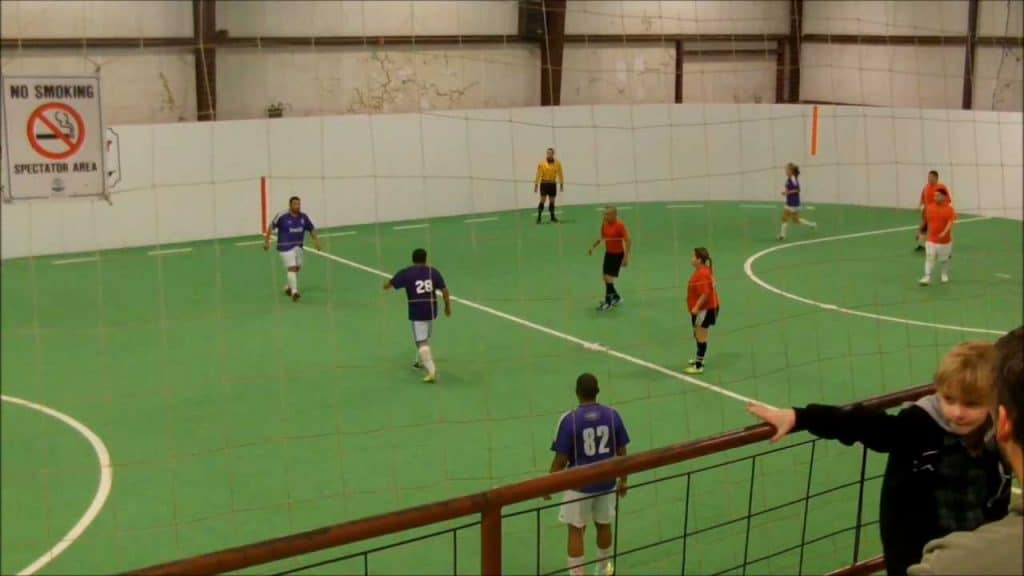 Players scattered around the indoor soccer court