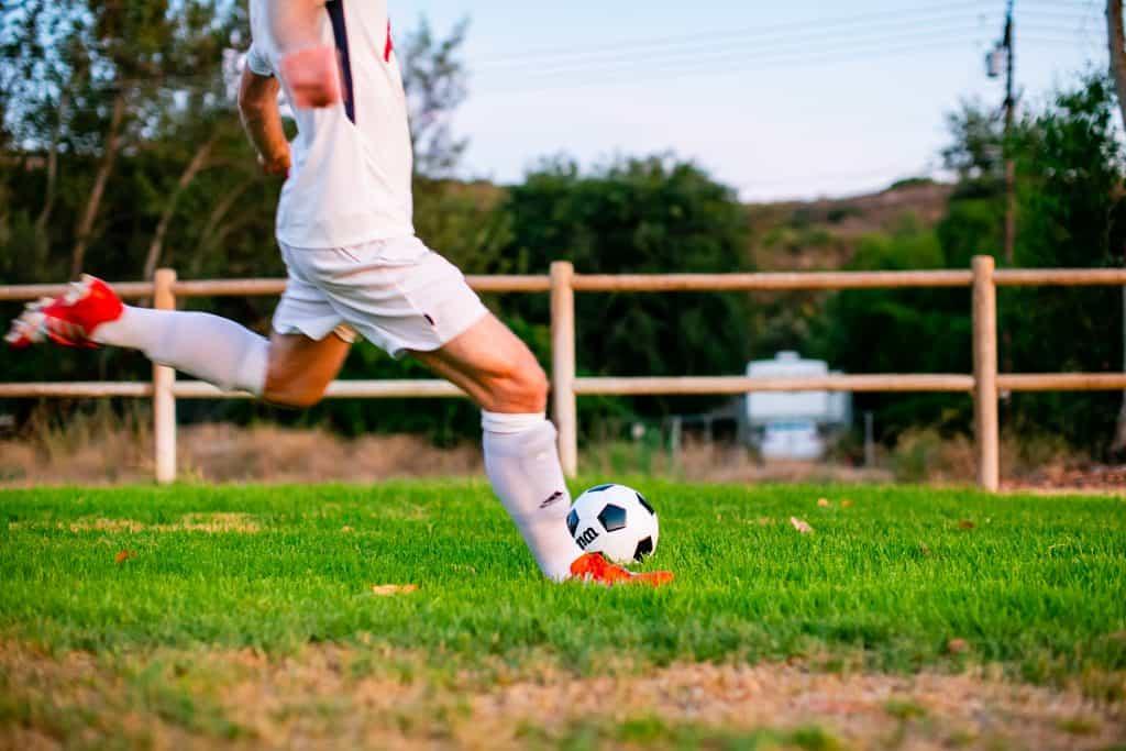 Man preparing to kick the soccer ball