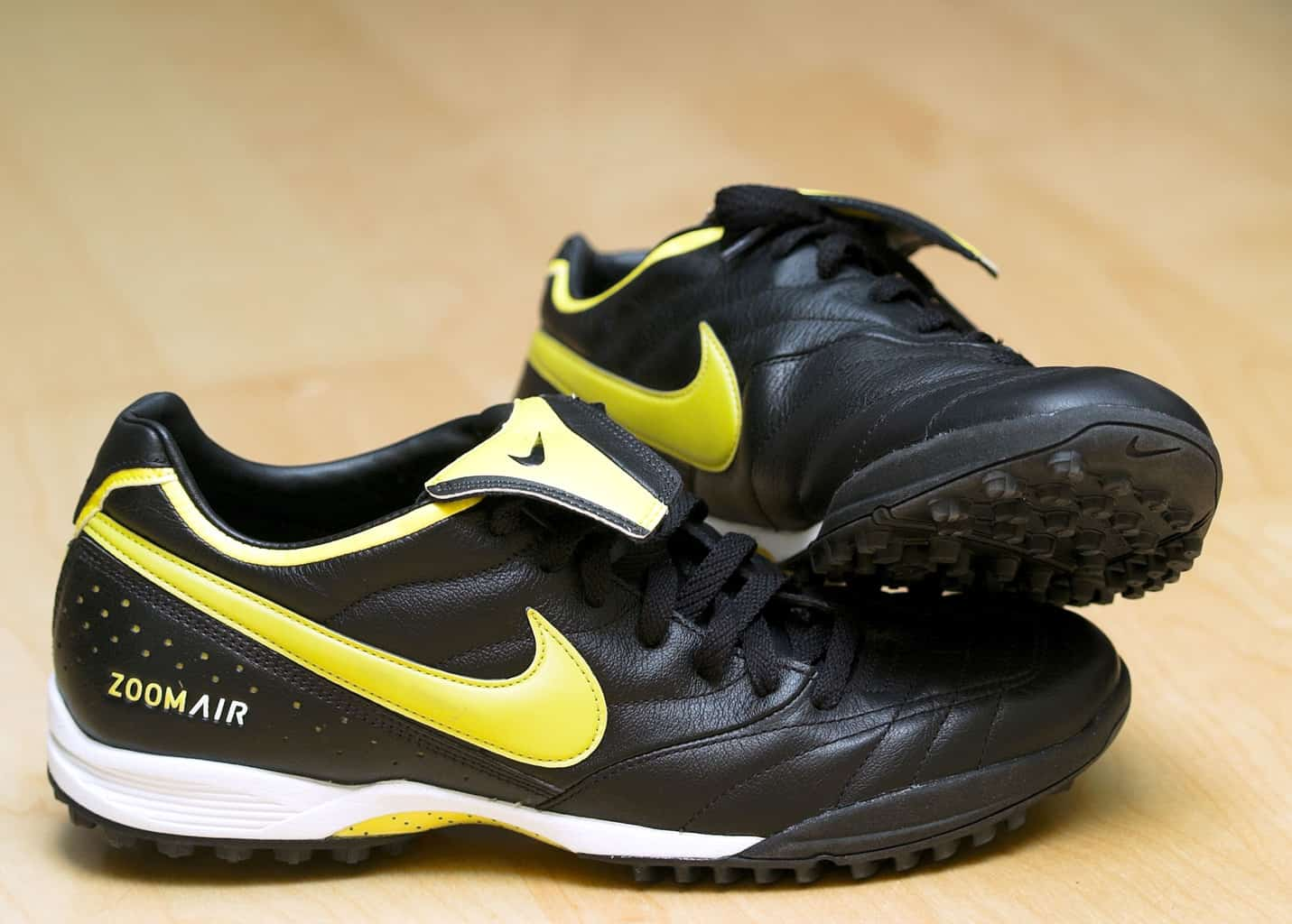 Black and gold Nike indoor soccer shoes