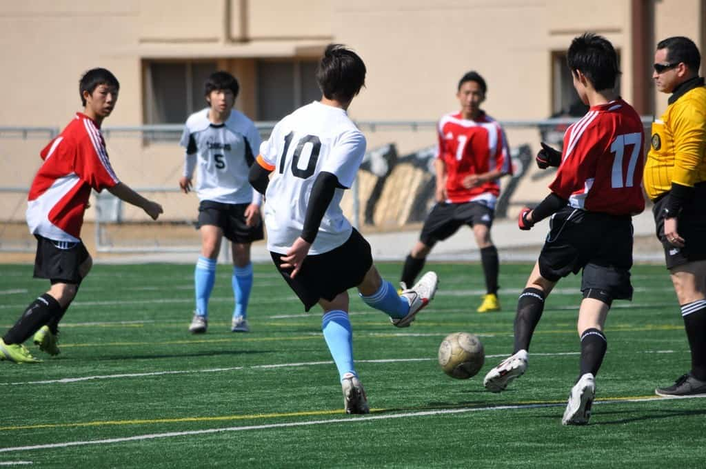 Ongoing soccer match with one defensive player