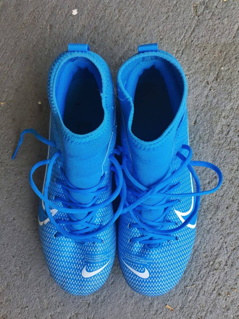 Blue Nike soccer cleats from a top down view