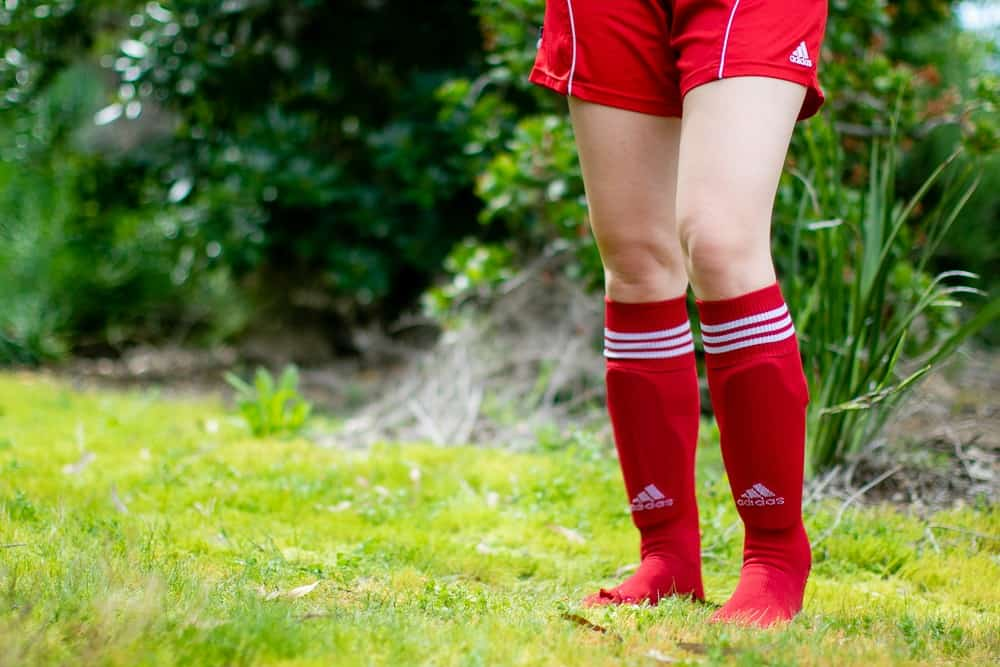 Girl in red shorts and high soccer socks