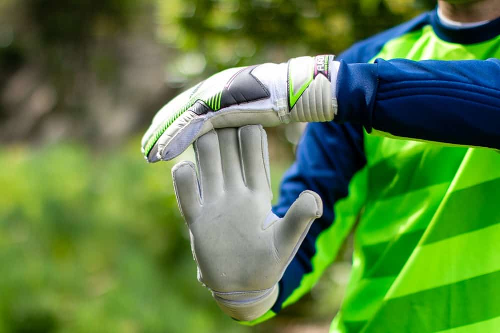 Man in white goalkeeper gloves