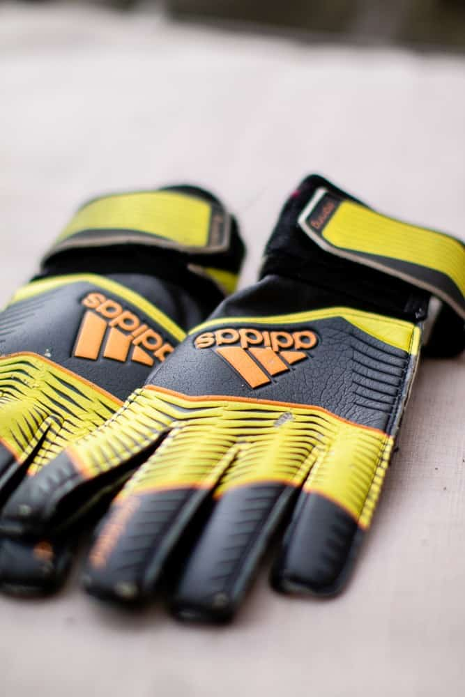 Top view of yellow and black goalie gloves