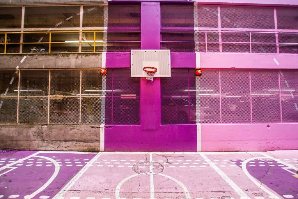 A purple toned basketball court