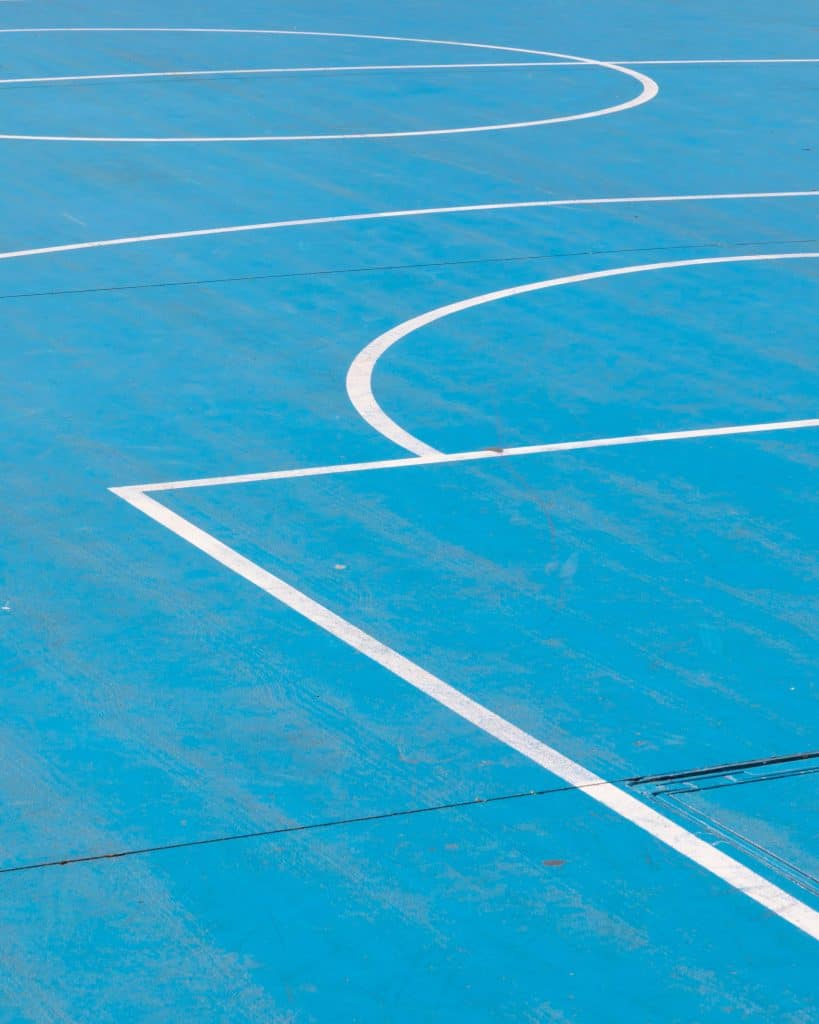 Close up of a blue basketball court