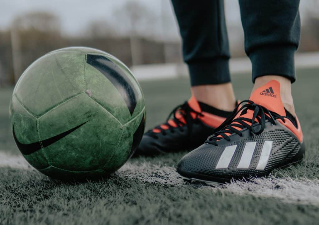 Close up of a soccer ball and some adidas soccer cleats