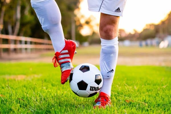 Man playing with a soccer ball using his feet