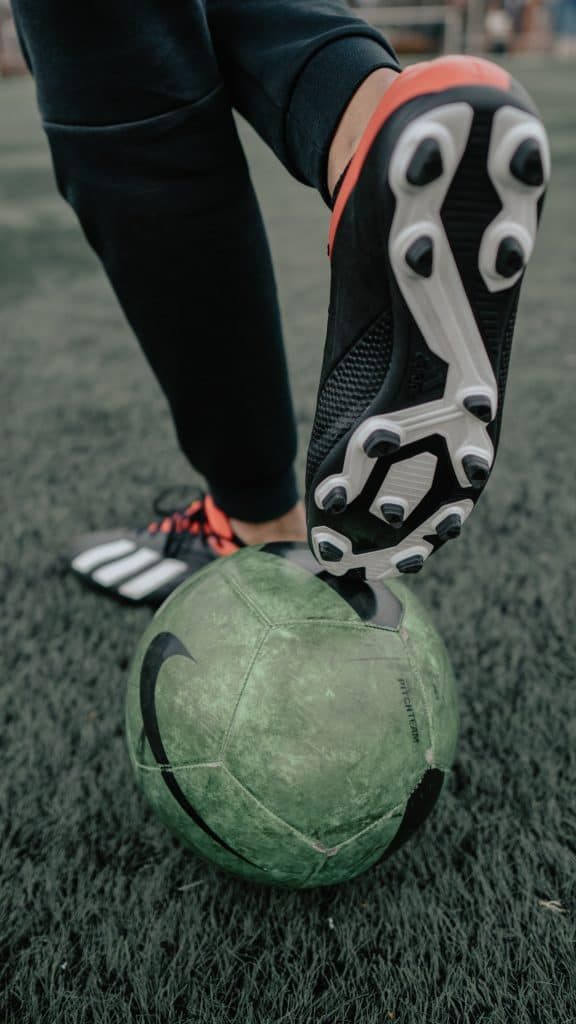 Rear of soccer cleats and a soccer ball