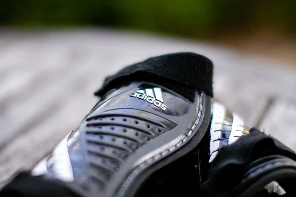 Close up of black adidas soccer cleats