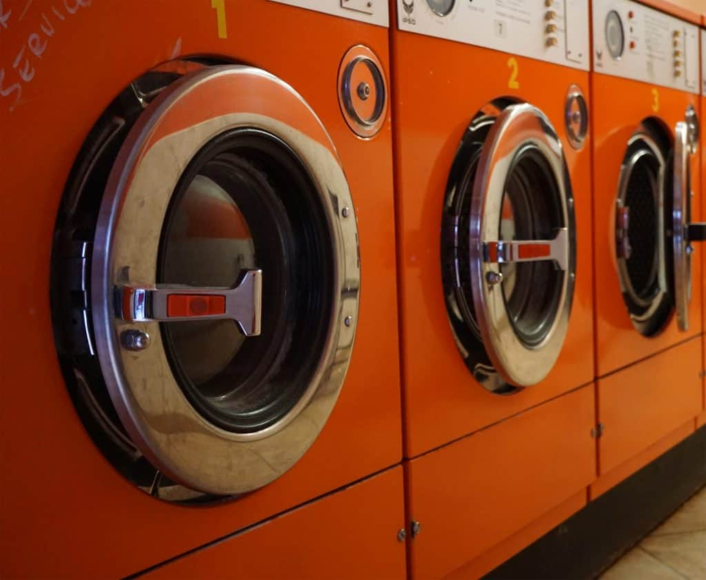 Row of bright orange washing machines