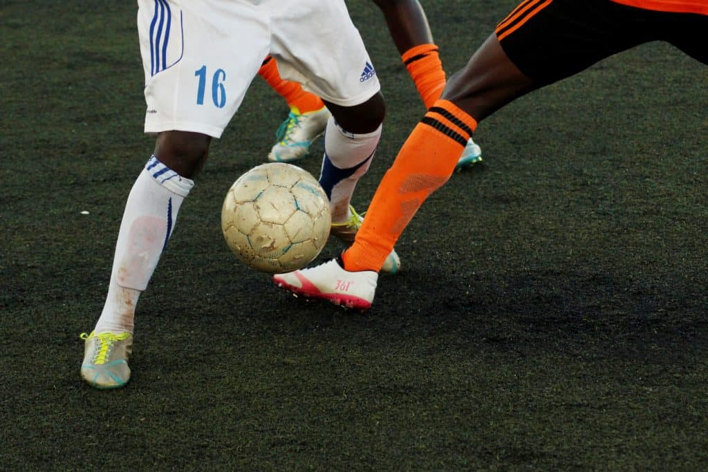 Close up of two soccer players going against each other