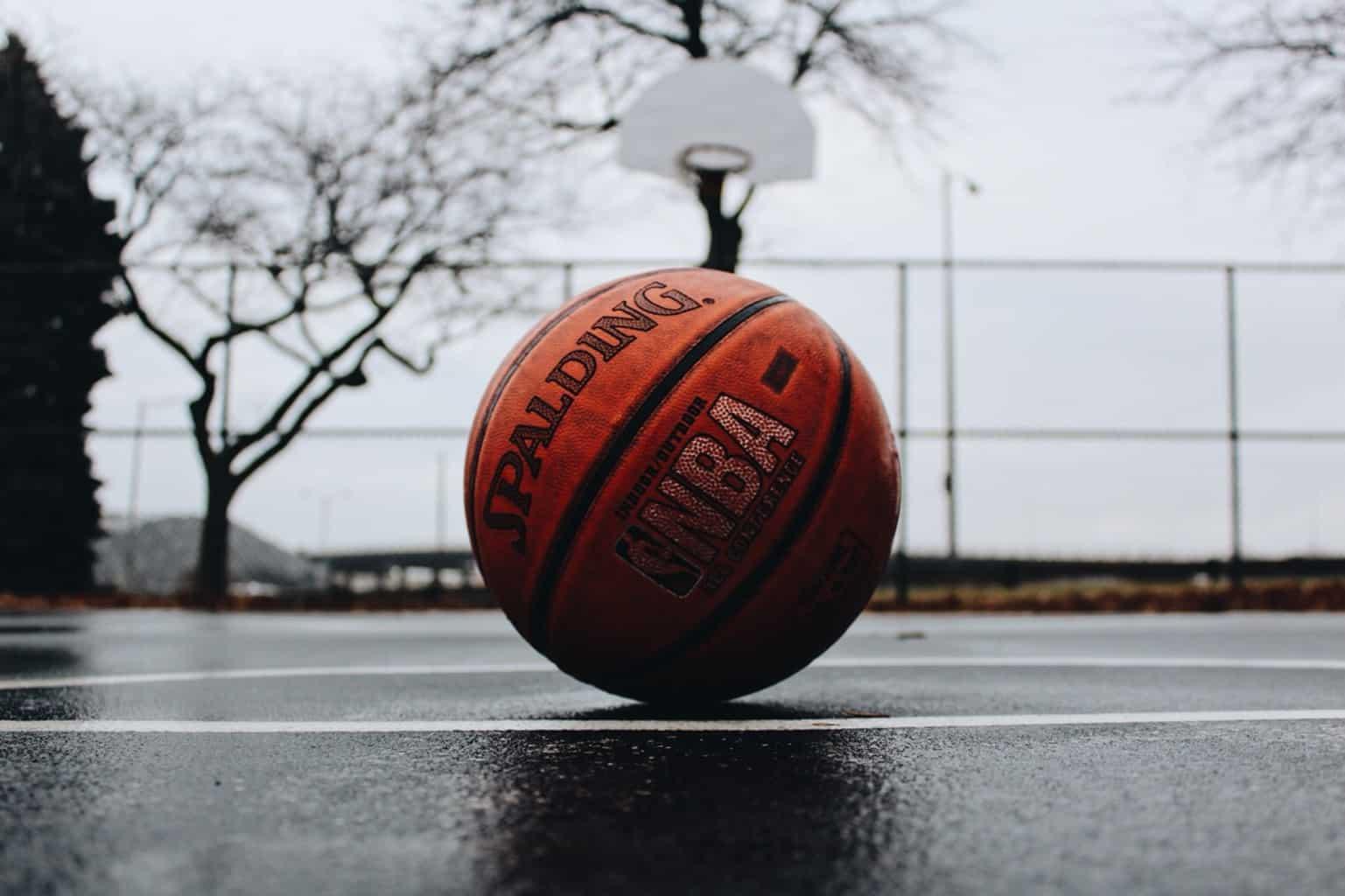 A basketball on an outdoor court