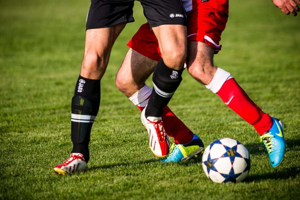 Men playing in a soccer field