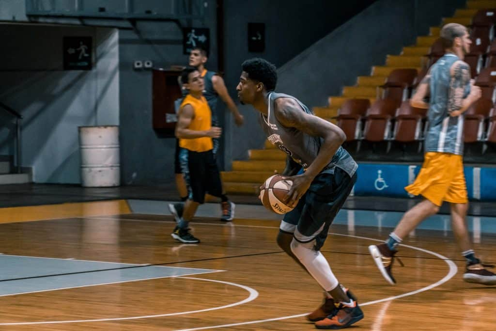 A basketball player about to shoot the ball along the free throw line