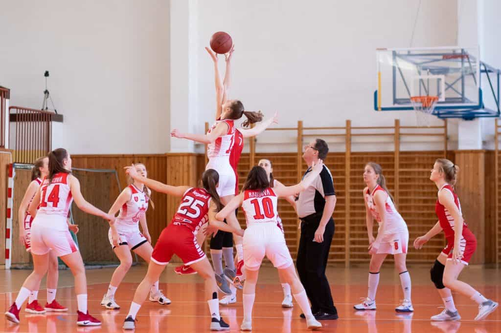A referee officiating a womens division basketball game