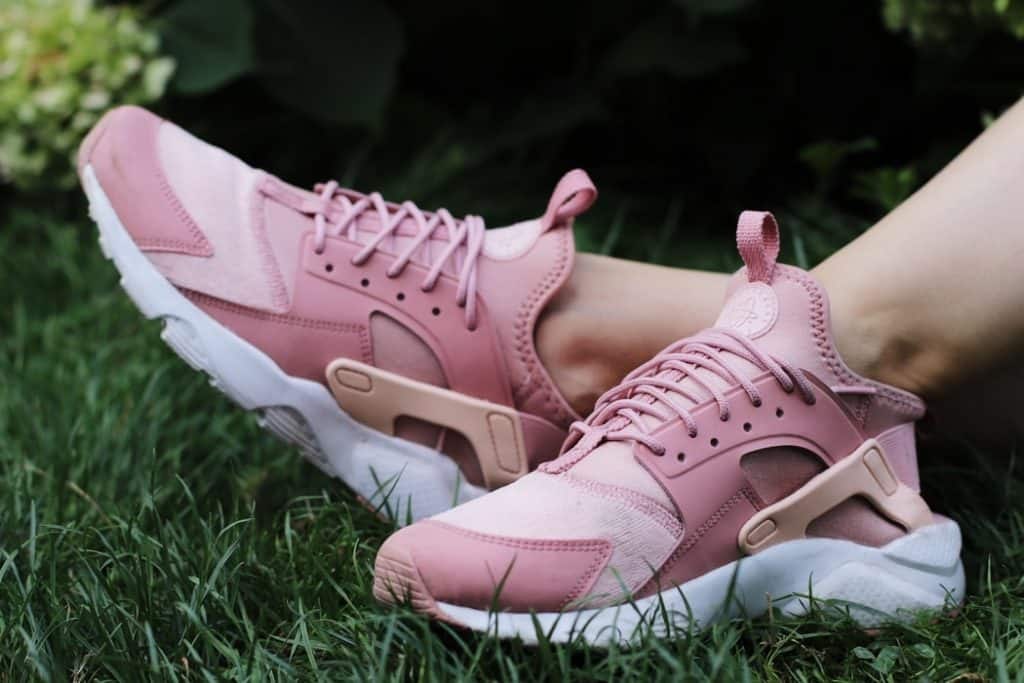Woman wearing pink Nike Huarache