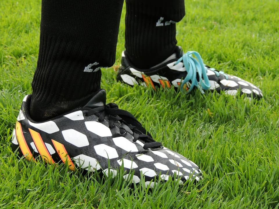 Soccer player wearing black and white design cleats