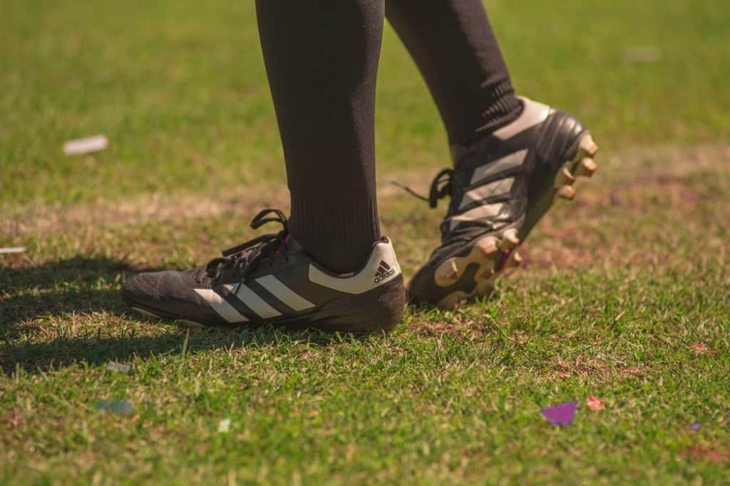 Person wearing soccer cleats standing on the field