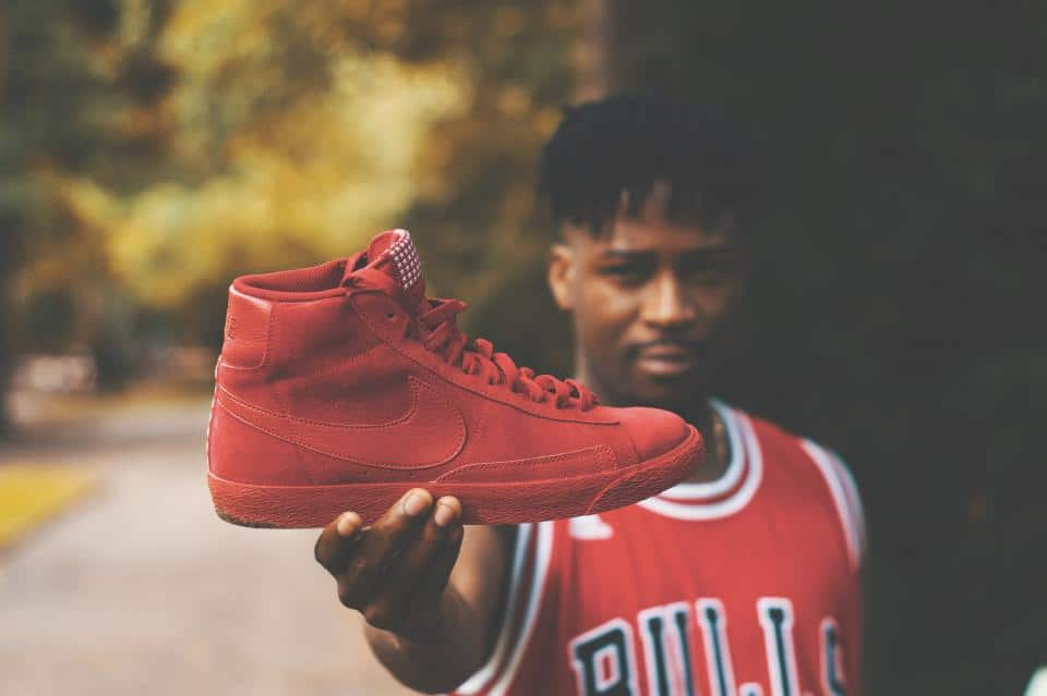 A man holding a basketball shoe