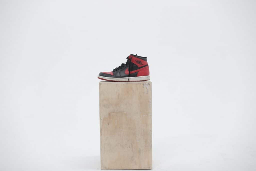 One half of a pair of a Lebron shoe displayed on a wood plank