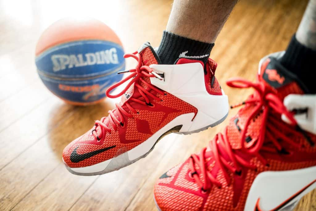 A basketball player wearing a pair of Lebron shoes