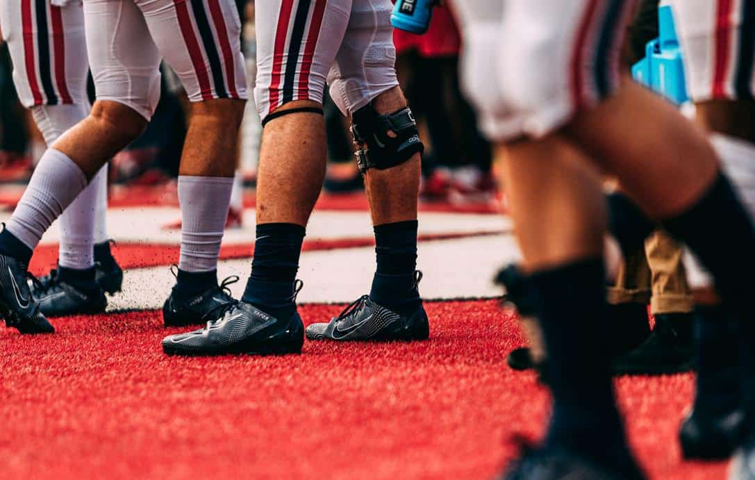 Close up of football players wearing their football cleats