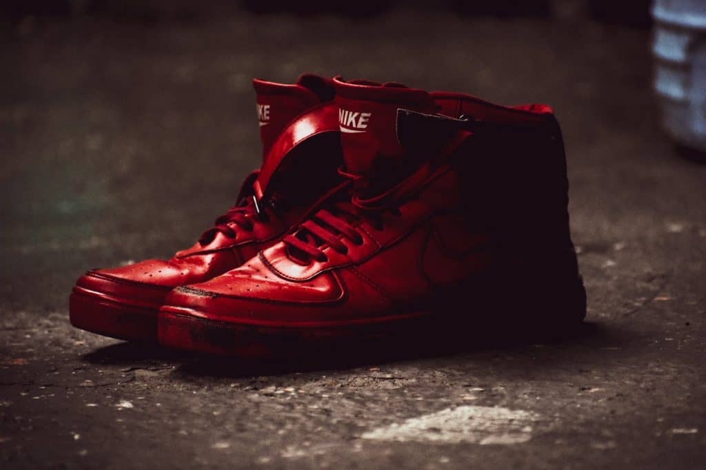 A pair of red basketball shoes on the ground