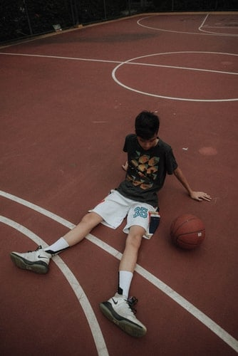 A player resting his flat feet after a basketball game