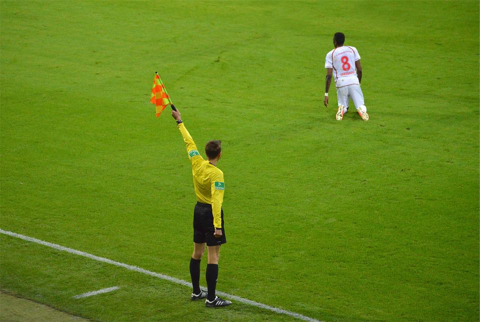 Soccer referee raising flag