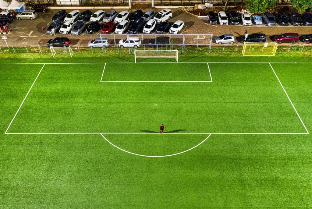 Man alone in a soccer field