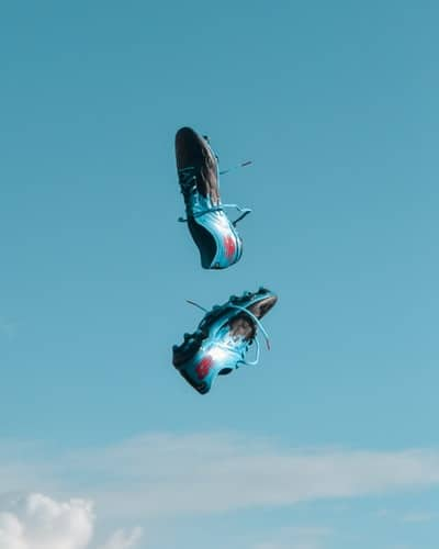 A pair of cleats thrown in mid air