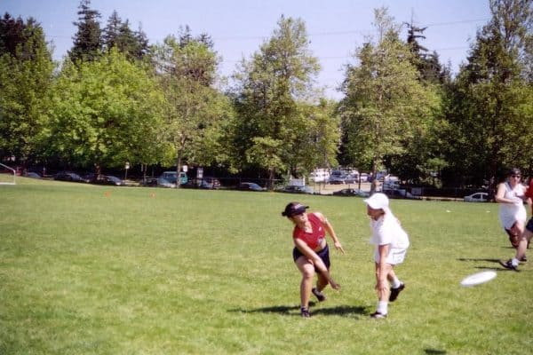 Ultimate Frisbee players wearing their cleats during a game