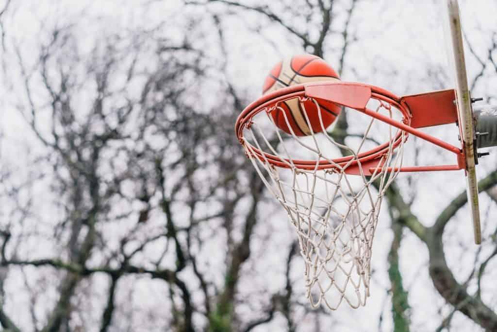 A basketball entering the basket