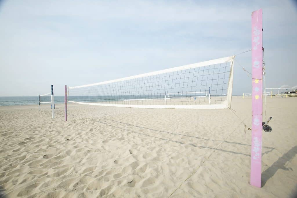 An outdoor volleyball net assembled in a beach