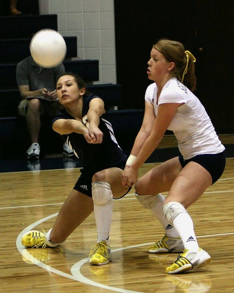 Libero wearing her best volleyball shoes while trying to hit a ball