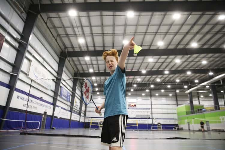 Man about to serve in badminton