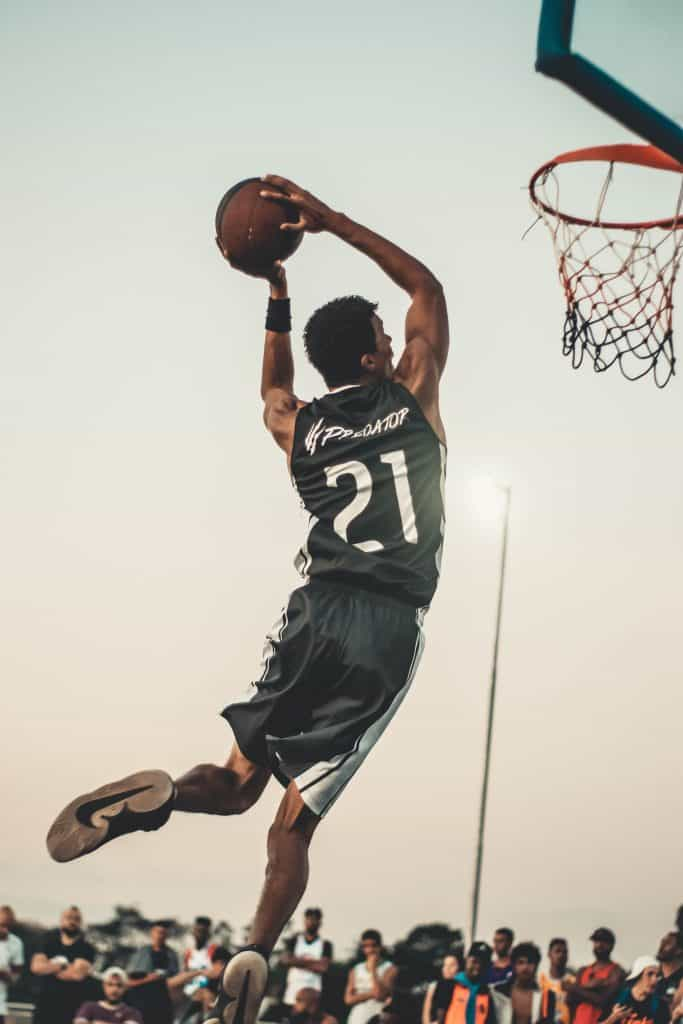 Player jumping to shoot a basketball