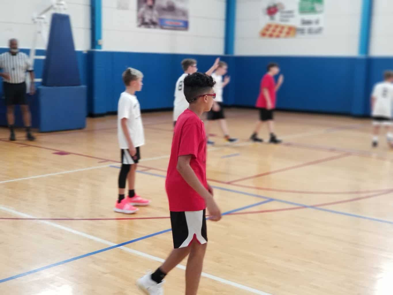 Kids wearing their best basketball shoes in the court