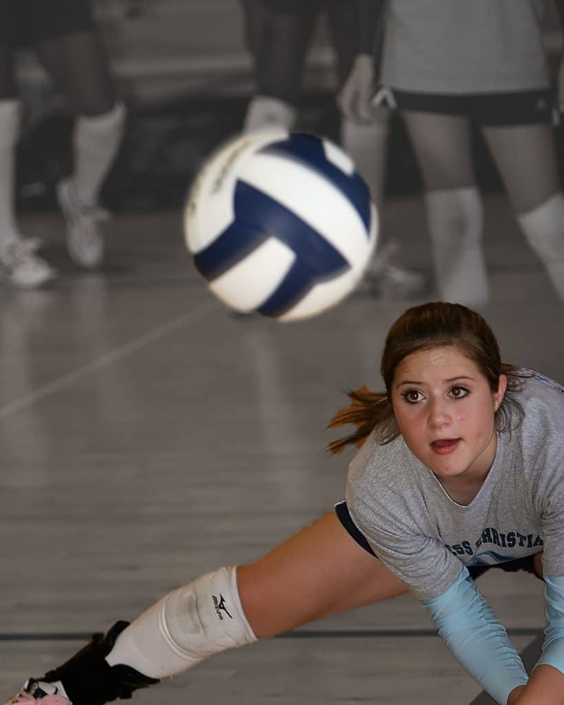 Volleyball player trying to save a game ball