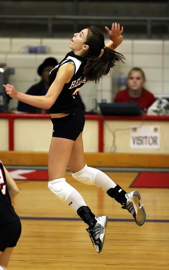 Woman about to spike in a volleyball game