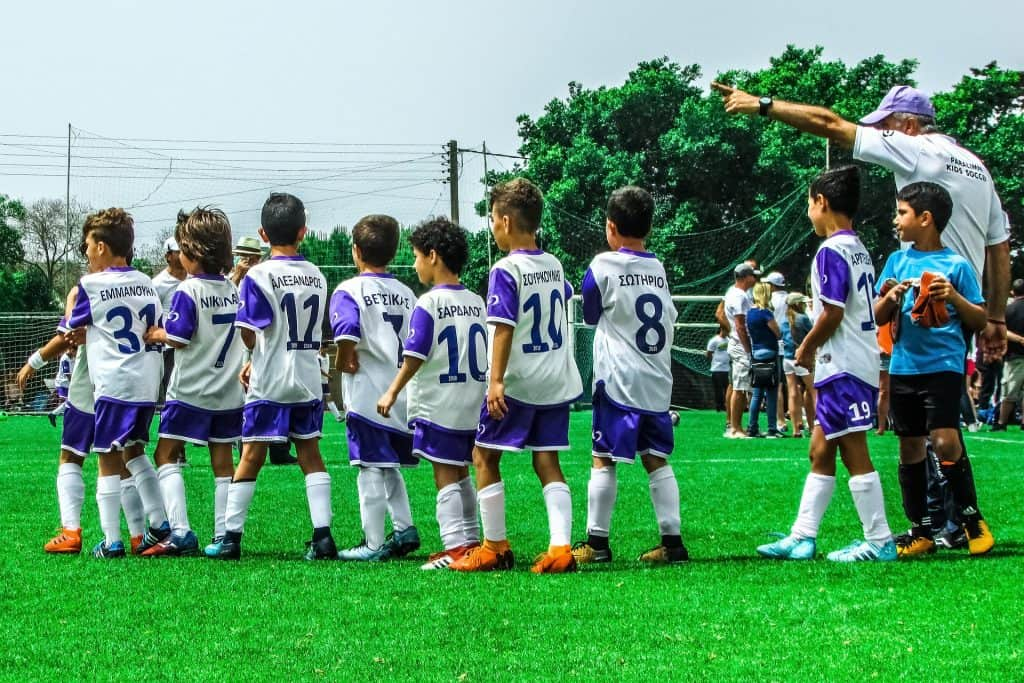 Kids lining up before a soccer match