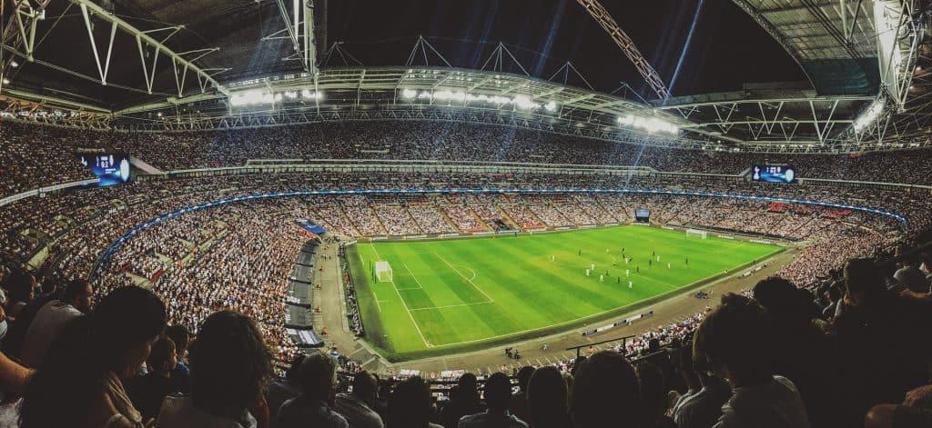 Spectators watch a long series of soccer games